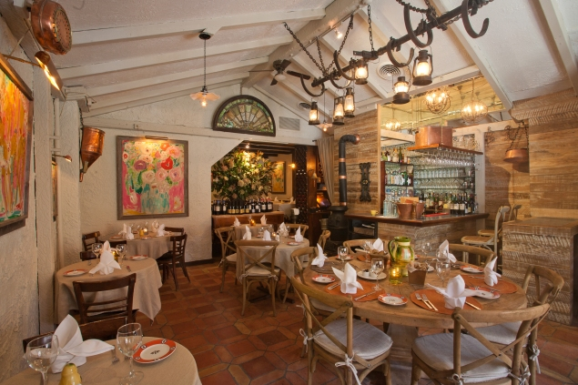 The restaurant's interior is a Provençal fantasia of copper pans, poppy paintings and arcane farm equipment. (Photo courtesy Shorine)
