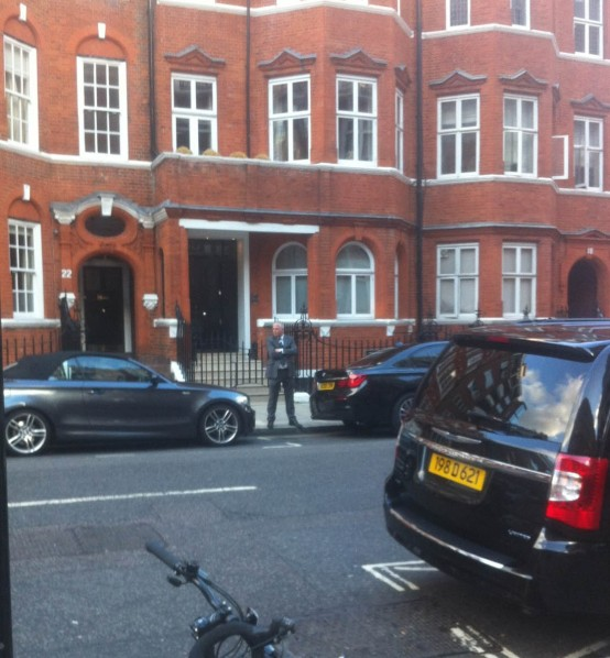 An MI5 officer keeping watch on Hans Crescent just ten feet from the embassy Photo by Jacques Hyzagi and Emily Lembo)
