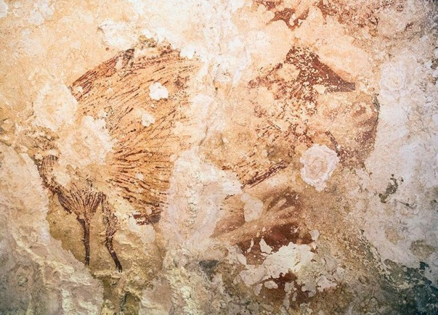 Cave paintings in Sulawesi, Indonesia. (Photo by Kinez Riza)