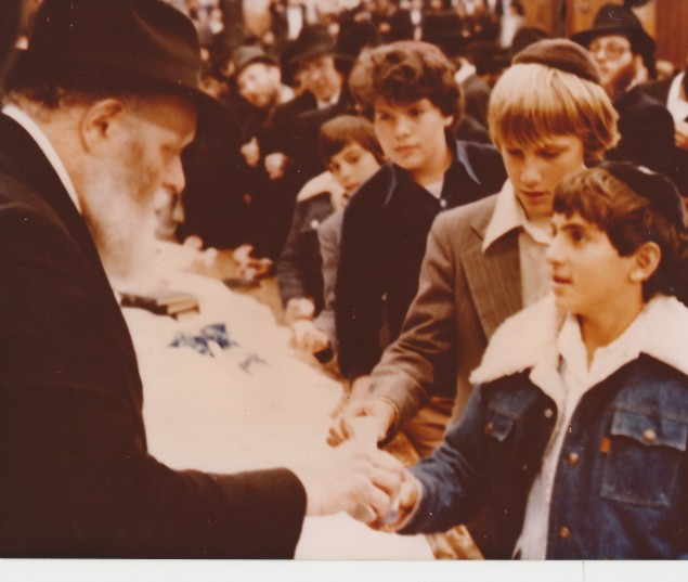 The rebbe greets a young Shmuley Boteach in Crown Heights.