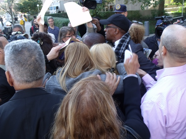 Former Assemblywoman Gabriela Rose, center right, is shielded by supporters as the media surrounds her outside court. (Photo: Jillian Jorgensen)