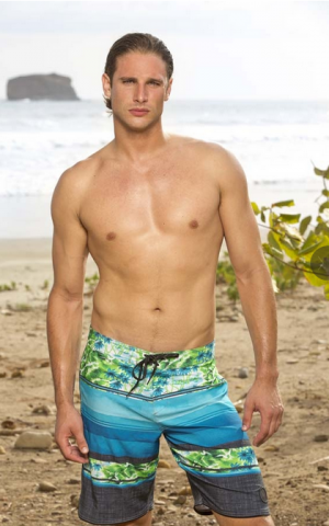 Drew Christy, just casually hanging on the beach. (CBS)