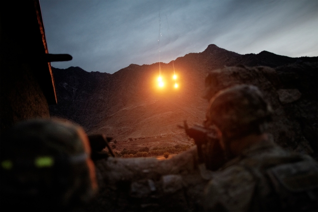 In the volatile Kunar Province, a Taliban safe haven along the border between Pakistan and Afghanistan, US Army soldiers of the 4th Infantry 4th Combat Division fire illuminating rounds to spot enemy fighters during a ground military operation. Afghanistan, 2012. (Photo by Sebastiano Tomada)