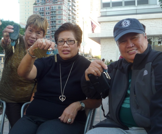 St. Joseph's tenants, from left: Nelida Valmona, Terry De La Paz, and Rose Jean Bulong. (Photo by Heather Dubin)