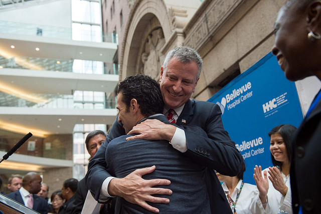 Mayor Bill de Blasio hugs Dr. Craig Spencer. (Photo: NYC Mayor's Office)