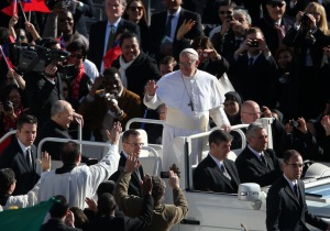 Pope Francis aboard the Pope-mobile. (Peter Macdiarmid/Getty Images)