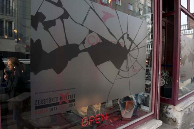 A sticker simulating broken glass on a window in Berlin commemorates the anniversary of the Kristallnacht. (Photo by JOHN MACDOUGALL/AFP/Getty Images)