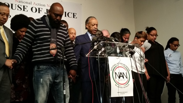 Rev. Al Sharpton prays with the Brown, Garner and Gurley families. (Photo: Ross Barkan)