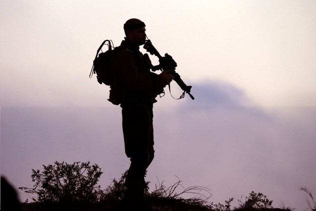 An Israeli soldier keeps his position near Israel's border with the Gaza Strip. (Photo by JACK GUEZ/AFP/Getty Images)