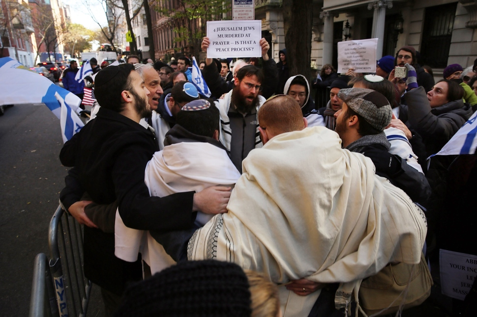 Pro-Israel protestors demonstrate in front of the Permanent Observer Mission of the State of Palestine to the United Nations following the murder in Jerusalem of four men by two armed Palestinians, November 18, 2014 in New York City. (Photo by Spencer Platt/Getty Images)