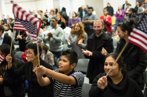 Immigrant activists watching President Obama's speech last night. (Photo by Kevin Hagen/Getty Images)