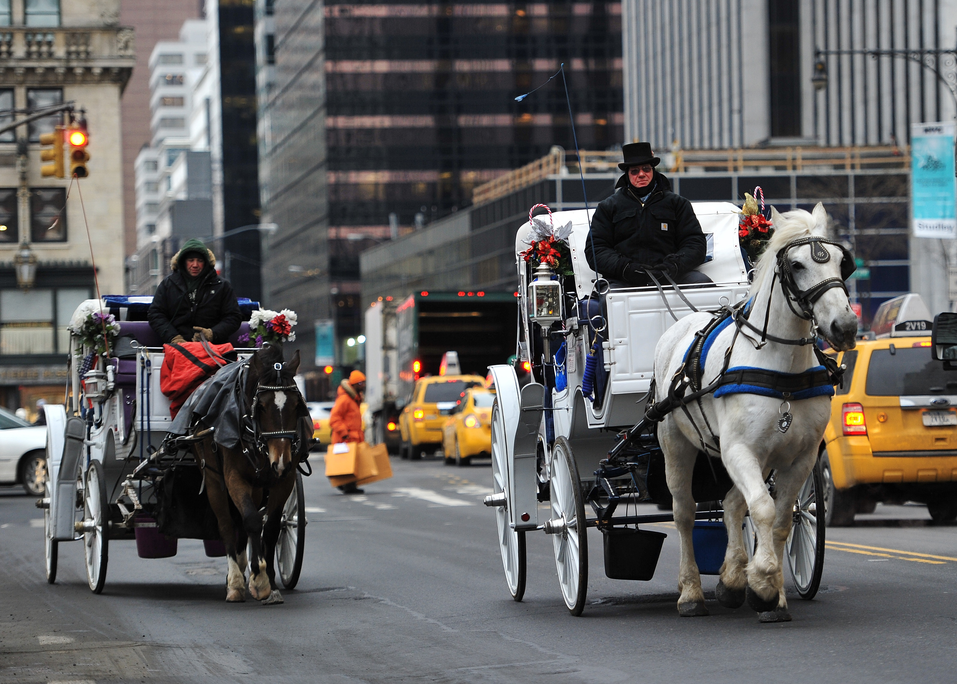 Two horse-drawn carriages are ridden on Central Park West on January 2, 2014.  (STAN HONDA/AFP/Getty Images)