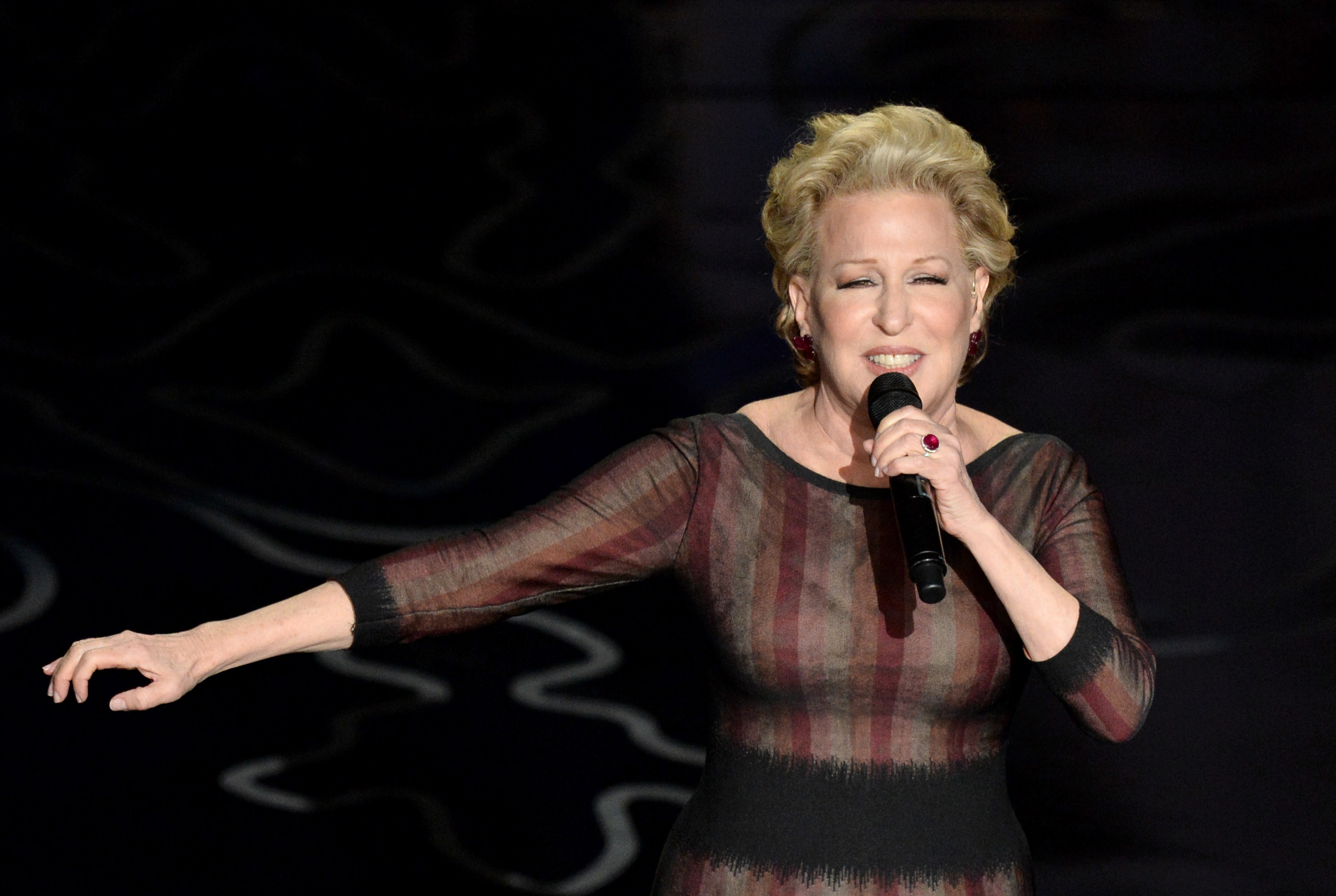 ette Midler performs onstage during the Oscars at the Dolby Theatre on March 2, 2014 in Hollywood, California.  (Photo by Kevin Winter/Getty Images)