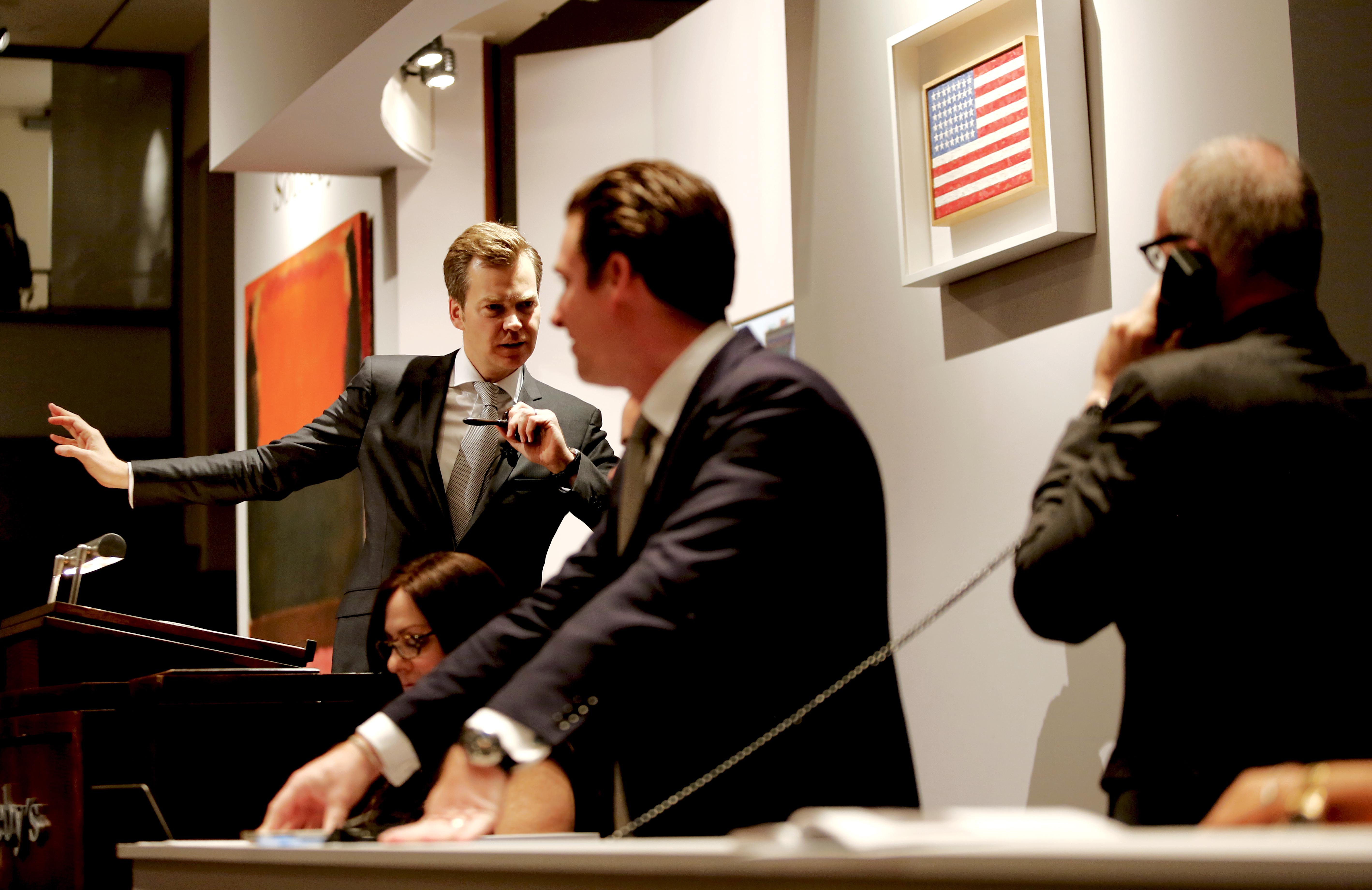 Oliver Barker coaxed bidders with charm at Sotheby's November 11 Contemporary Art Evening Sale. (Photo courtesy Sotheby's)
