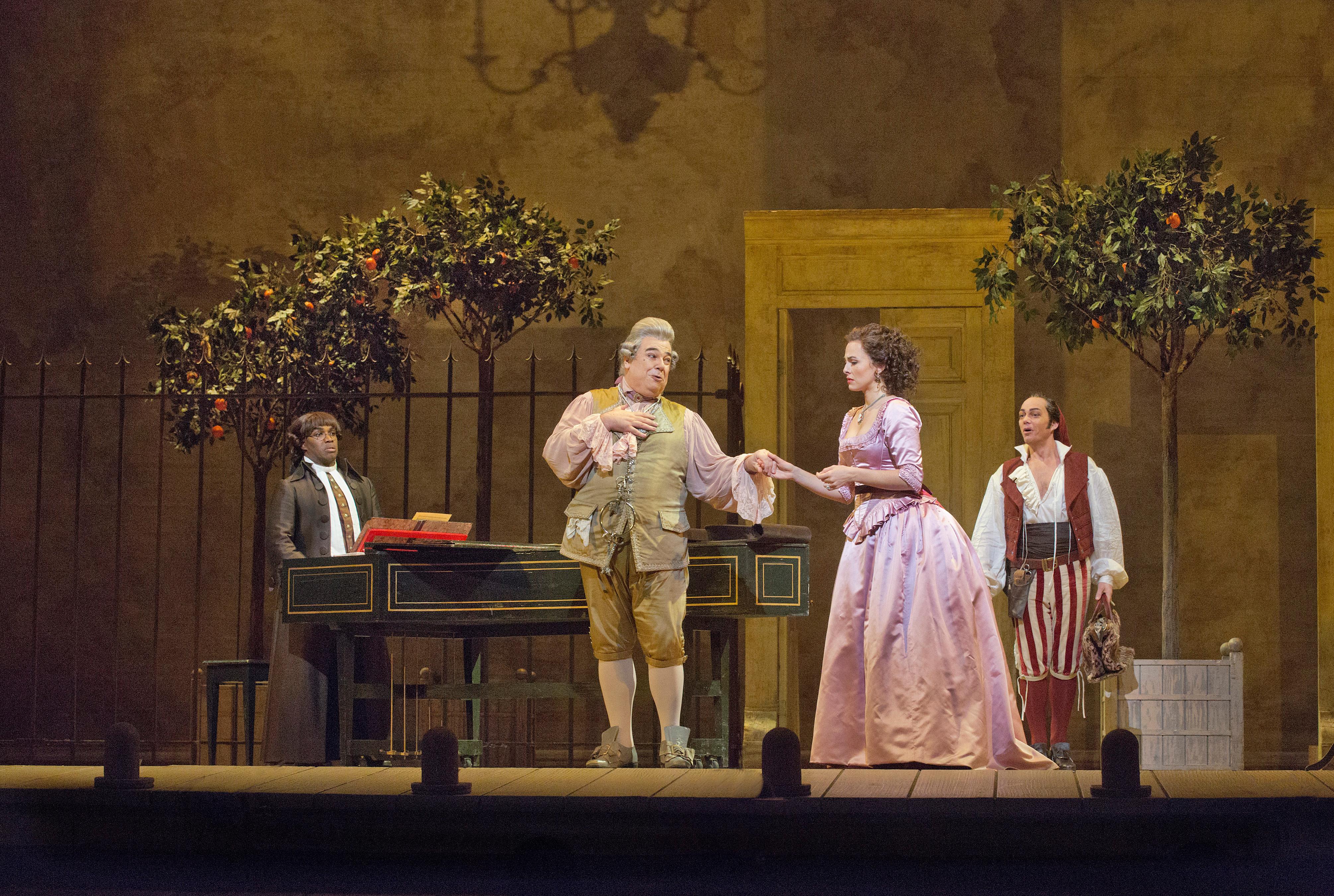 In the Met's production of Rossini's Il Barbiere di Siviglia, Maurizio Muraro (second from left) delivers a subtle, regal performance.