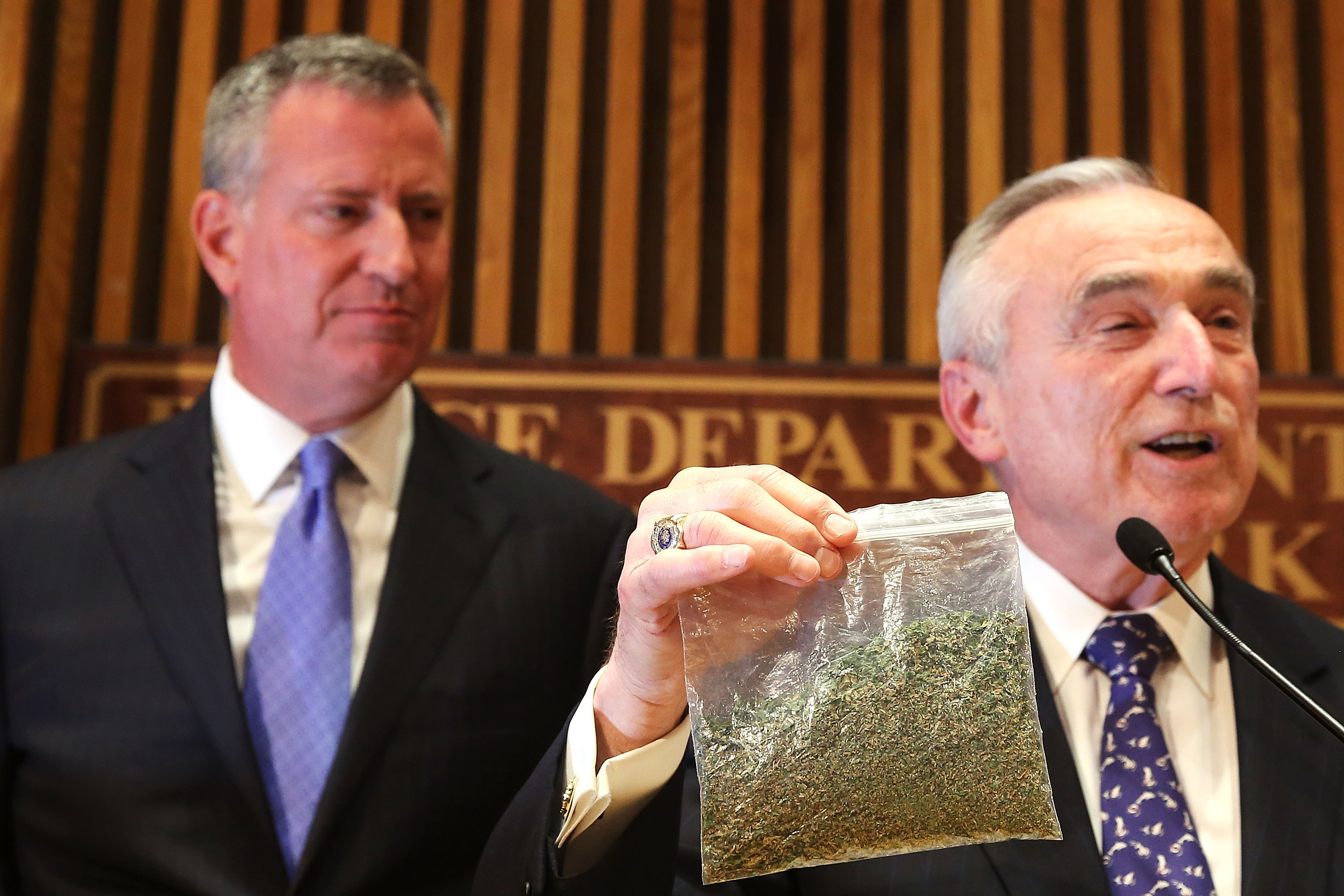 New York City Police Commissioner Bill Bratton holds up a bag of oregano to demonstrate what 25 grams of marijuana looks like at a news conference to announce changes to New York's marijuana policy.  (Photo by Spencer Platt/Getty Images)
