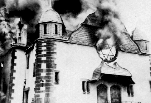 A synagogue burns during the Kristallnacht. (Photo via Wikimedia Commons)