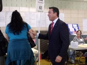 Congressman Michael Grimm greets a voter at his polling place Staten Island. (Photo: Jillian Jorgensen)