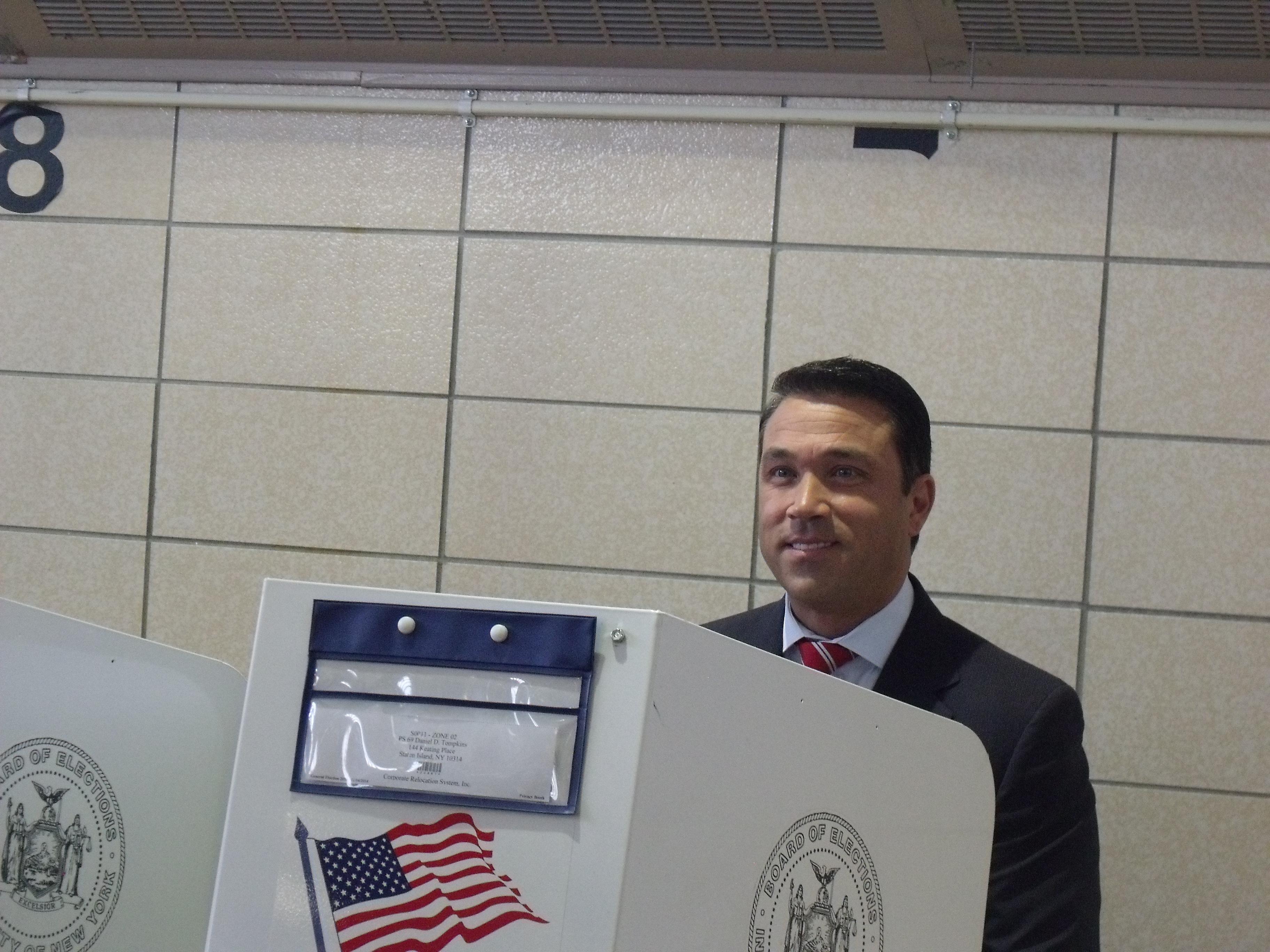 Congressman Michael Grimm casts his vote today at PS 69 on Staten Island. (Photo: Jillian Jorgensen)