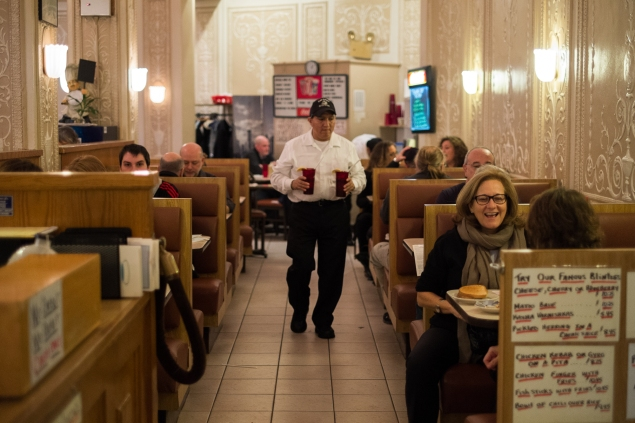 Café Edison's long walkway is filled with friendly chatter. (Photo credit: Julius Motal/New York Observer)