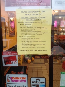 Flyers decrying a planned QuickChek hang in the windows of several local businesses