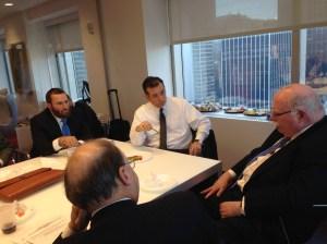 Sen. Cruz enjoys a green pepper while listening to hosts Shmuley Boteach (l) and Michael Steinhardt (r).