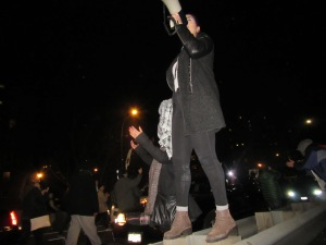 A Ferguson demonstrator chants into a megaphone from atop a guard rail on the FDR Drive (Photo: Will Bredderman)..........