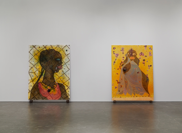 "Installation view of ""Chris Ofili: Night and Day"" at New Museum, 2014, featuring No Woman, No Cry, 1998, and The Holy Virgin Mary, 1996. (Photo by Maris Hutchinson/EPW. All artworks © Chris Ofili. Courtesy David Zwirner, New York/London)"