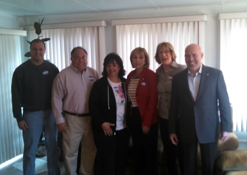 Third district Republican congressional candidate Tom MacArthur joins Lt. Gov. Kim Guadagno and supports during a retail politicking stop in Toms River Saturday.