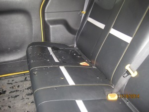 Three passengers were sitting in this taxi when the roof caved in.