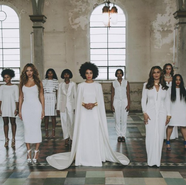 Solange posed with her sister, Beyoncé, mother, Tina Knowles, and other friends and family in this wedding portrait shot by Rog Walker. (Photo via instagram.com/beyonce)