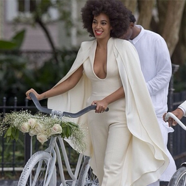 Solange walks her bicycle while wearing a Stéphane Rollande jumpsuit. (Photo via instagram.com/beyonce)