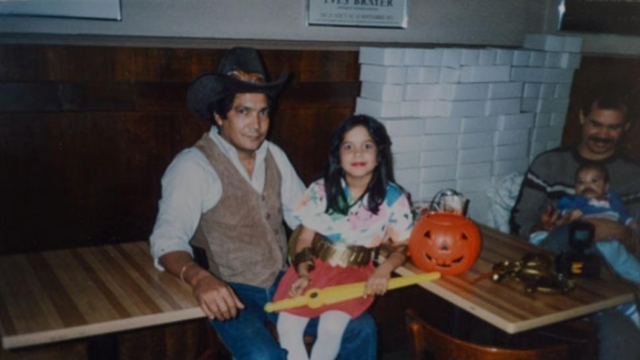 "Ms. Martinez and her father on Halloween. ""He was very handsome,"" Ms. Martinez said."