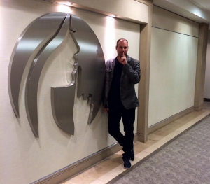 Mr. Biderman poses with an Ashley Madison sign. (Facebook)