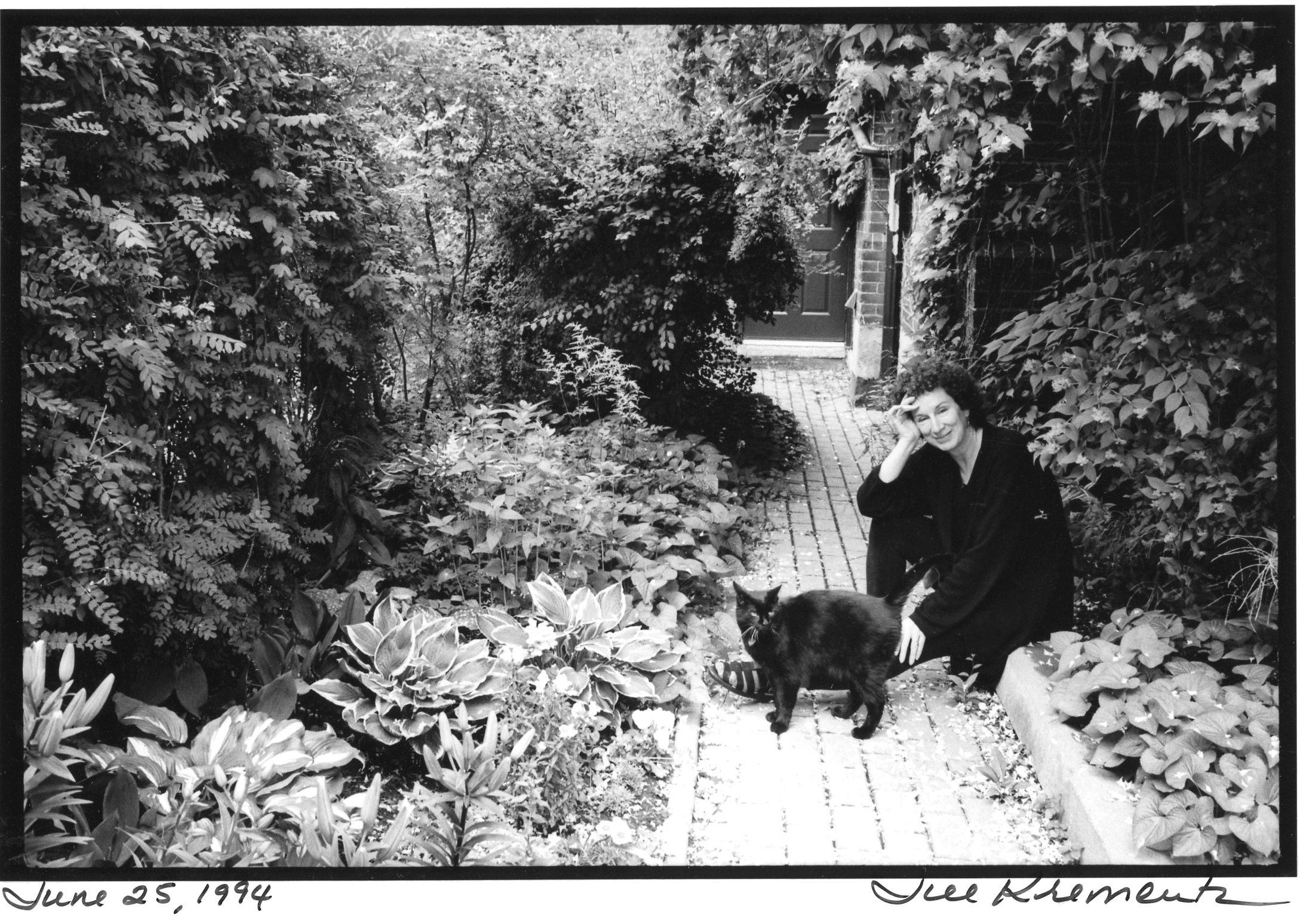 Margaret Atwood, an avid horticulturist, with her cat Blackie in Toronto, June 25, 1994, photographed by Jill Krementz.