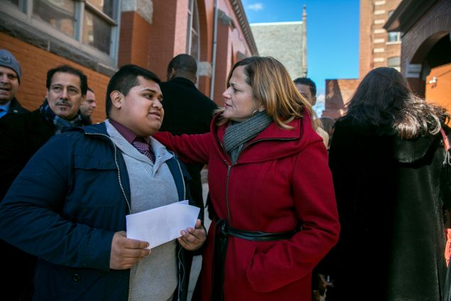 Council Speaker Melissa Mark-Viverito with Cesar Pena at the signing of immigration legislation in New York.