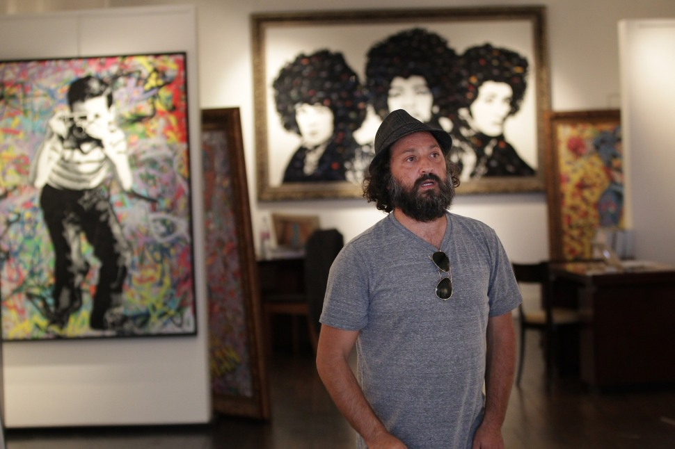 LONDON—Pop artist and film maker Thierry Guetta, known as Mr Brainwash, views his art works at the Opera Gallery on October 3, 2011. (Peter Macdiarmid/Getty Images)