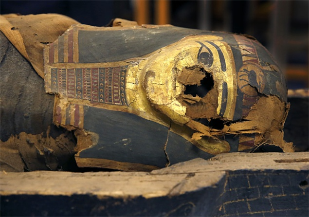 The Chicago Field Musuem has taken the lid off of a 2,500-year-old mummy to get it ready for traveling exhibitions. (AP Photo/Charles Rex Arbogast)