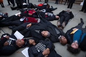 """Council members participate in a """"die-in"""" outside City Hall to protest the Eric Garner grand jury decision. (Photo: William Alatriste/NYC Council)"""