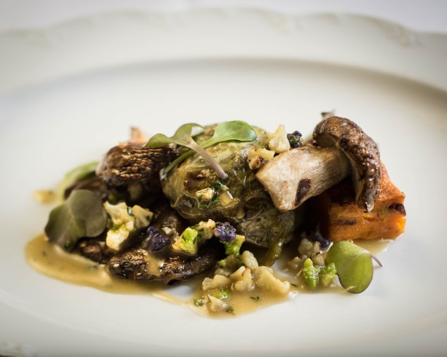 Porcini mushrooms with duxelle stuffed cabbage, sweet potato gratin and lemon thyme jus. (Photo by Francesco Sapienze)