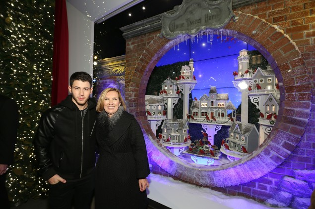Nick Jonas and Liz Rodbell celebrating the Lord & Taylor windows. (Photo via Getty)