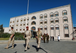 Yemeni soldiers walks outside the Yemeni Defense Ministry in Sanaa on December 6, 2014 after American journalist Luke Somers and a South African hostage were killed during a failed attempt by US special forces to free them from Al-Qaeda militants in Yemen.  (MOHAMMED HUWAIS/AFP/Getty Images)