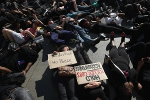 Demonstrators during a die-in. (Photo by David McNew/Getty Images)