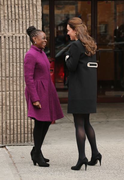 The First Lady's magenta coat stands out on this freezing NYC day. (Photo via Getty)