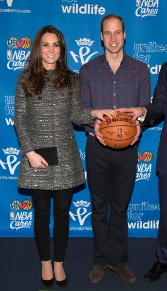 The Duchess and Duke looking excited, if a little trepidatious, to hold a basketball. (Photo via Getty)