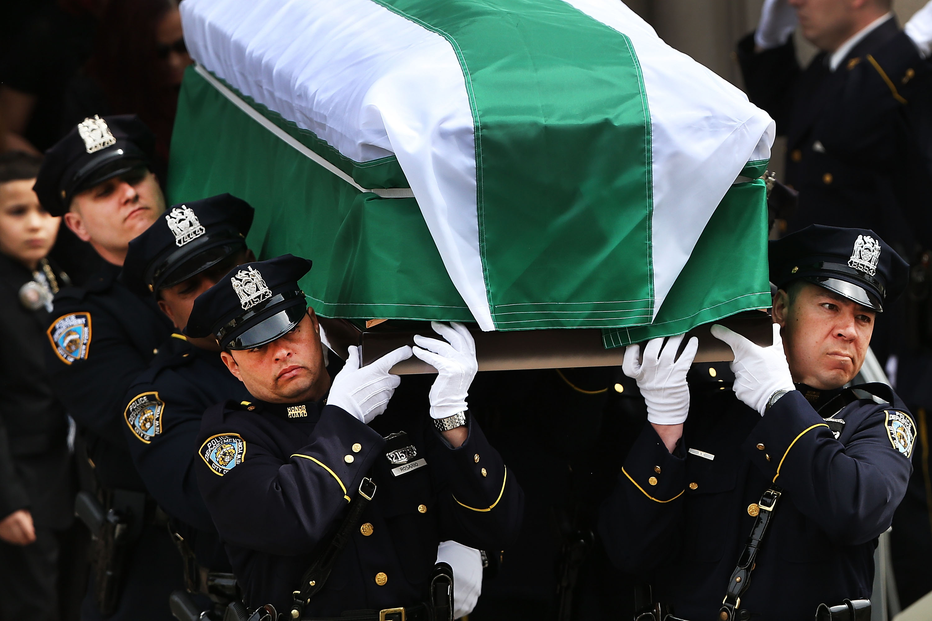 A funeral for a police officer in April. (Photo by Spencer Platt/Getty Images)