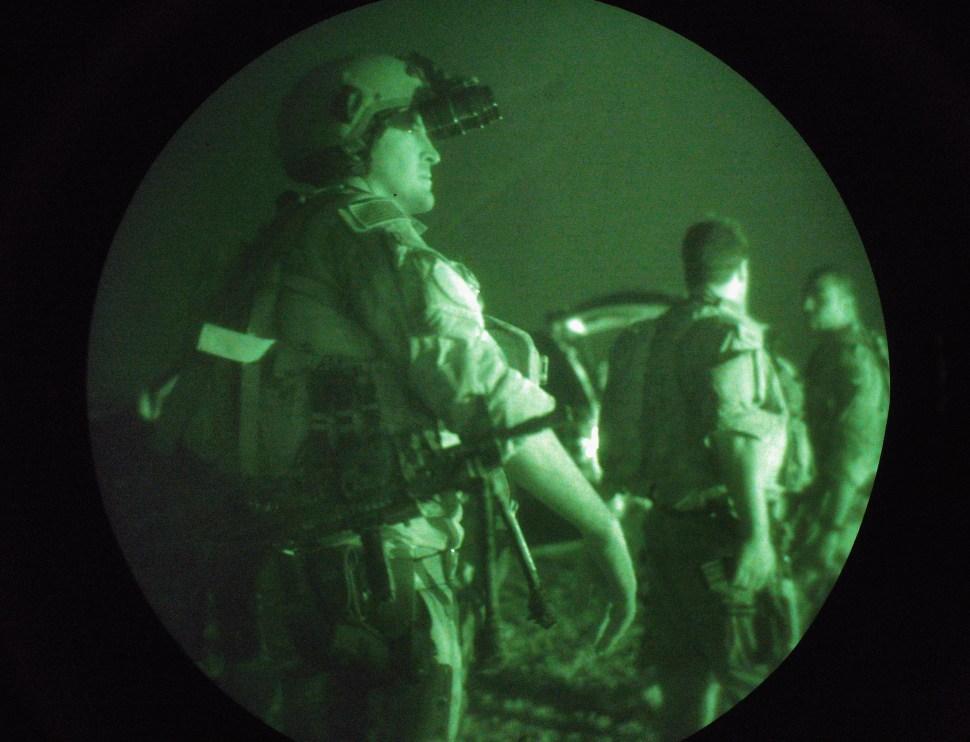 U.S. Navy SEALS await a night mission to capture Iraqi insurgent leaders July 27, 2007 near Fallujah, Iraq. (Photo by John Moore/Getty Images)