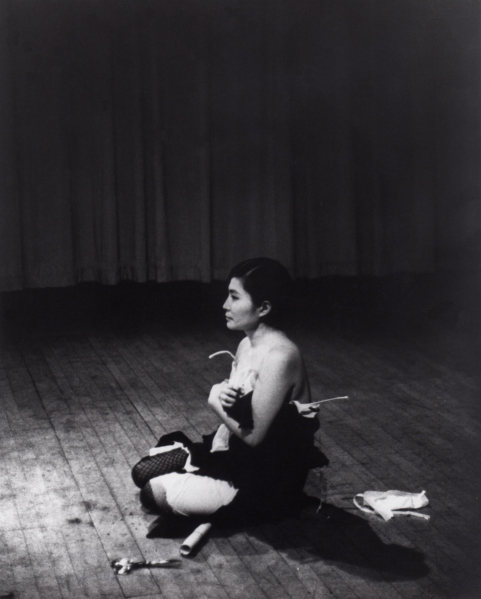 Cut Piece (1964) performed by Yoko Ono in New Works of Yoko Ono, Carnegie Recital Hall, New York, March 21, 1965. (Photograph by Minoru Niizuma. © Minoru Niizuma. Courtesy Lenono Photo Archive, New York)