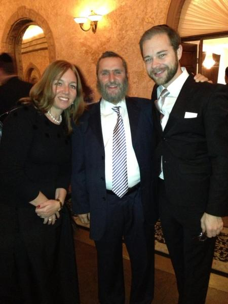 The author with his wife and the ad's subject, Rennick Remley, at a wedding in November 2012.