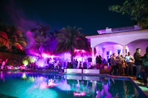 A mansion, lit up in purple. (Photo by David X Prutting/BFAnyc.com)